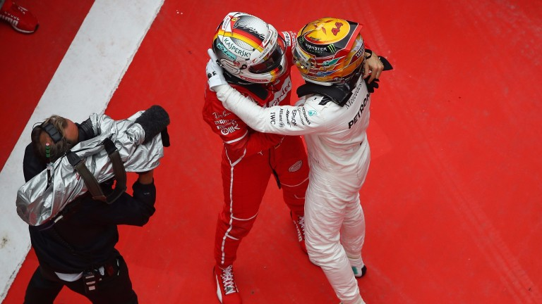 Sebastian Vettel (left) and Lewis Hamilton look set for a fierce championship battle
