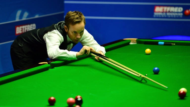 Ali Carter in action against Alan McManus at The Crucible last year