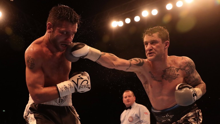 Ricky Burns lands a big right on Kiryl Relikh