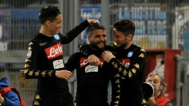 Lorenzo Insigne (centre) celebrates a goal with his Napoli teammates