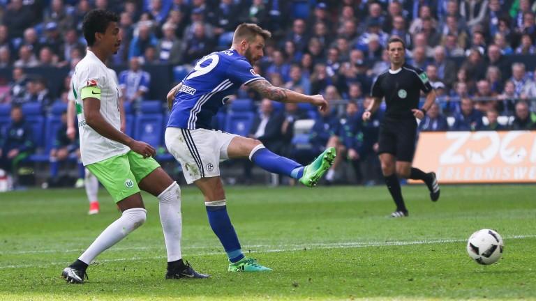 Schalke's Guido Burgstaller scores a goal