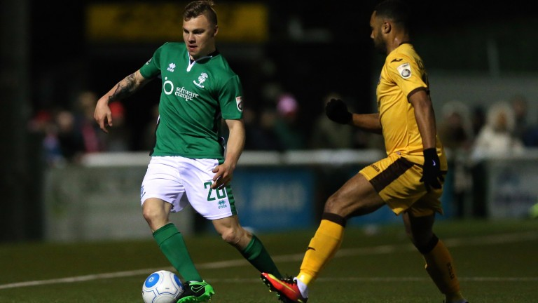 Sean Raggett (left)'s Lincoln have won five successive league games since their draw at Sutton United