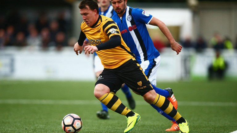 Maidstone's Alex Flisher gets away from Joe Rafferty of Rochdale during their FA Cup match