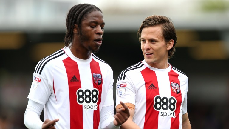 Brentford's Romaine Sawyers (left) speaks with Lasse Vibe