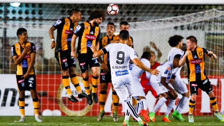 Ricardo Oliveira curls in the opener for Santos in their 2-0 home win over The Strongest in Sao Paulo last month