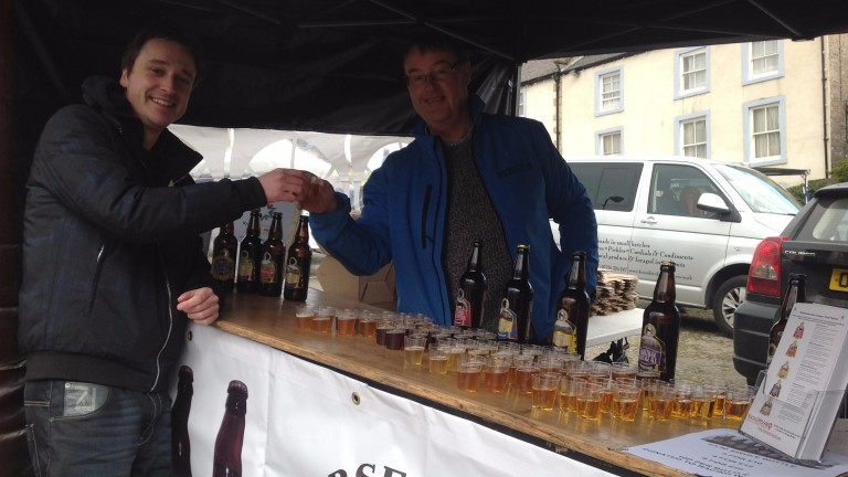 Howard Kinder (right), founder of the Horsetown Beer Company, offers Radio Yorkshire's Bobby Beevers a drink at the Middleham Open Day