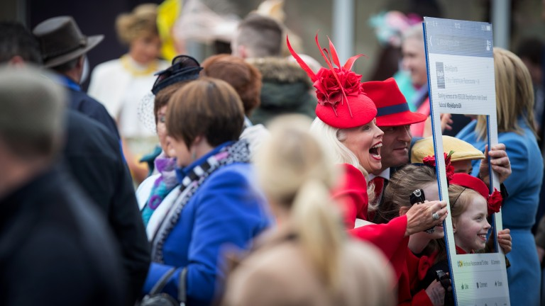 A family in matching colours pose for an Instagram photo at Fairyhouse in April