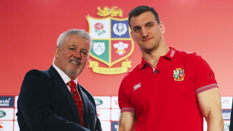 Lions head coach Warren Gatland  shakes hands with his captain Sam Warburton