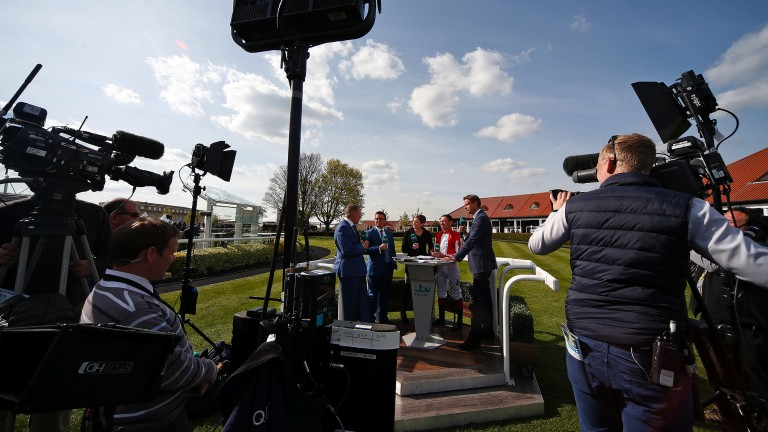 Lights, camera, action: the ITV Racing crew with Nell Gwyn winning jockey Frankie Dettori in the winner's enclosure