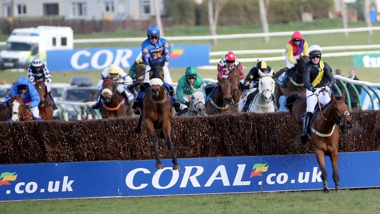 Alvarado (blaze, left) is about to jump the last and go in pursuit of Vicente (centre) in last year's Coral Scottish Grand National