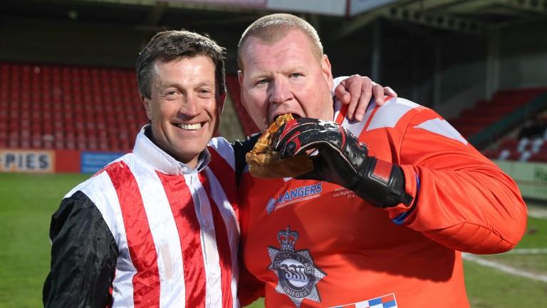 Goalkeeper Wayne Shaw, complete with pie, gets ready to face Carl Llewellyn in the penalty shootout