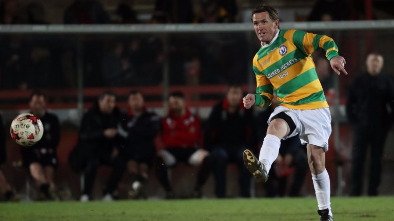 Sir AP McCoy: takes a shot on goal against the Cheltenam Town Legends
