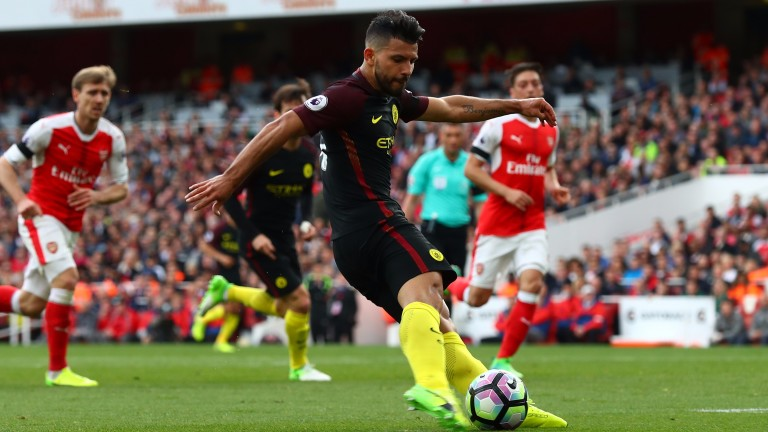 Sergio Aguero of Manchester City scores during the Premier League match at Arsenal