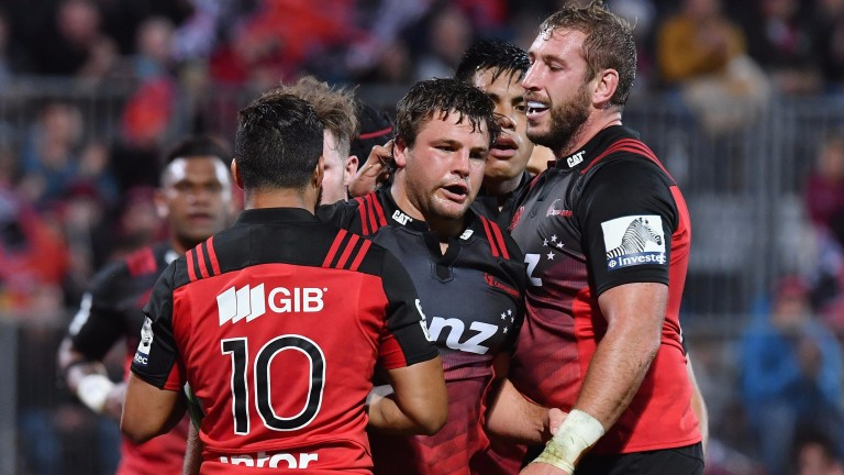 The Crusaders celebrate one of eight tries against Sunwolves last Saturday