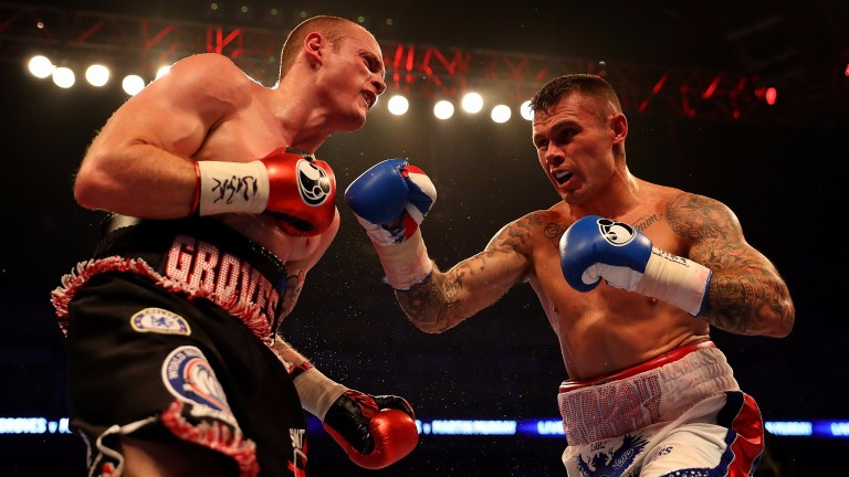 Martin Murray (right) throws a punch at George Groves