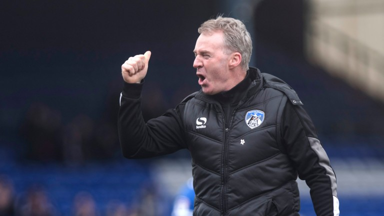 Oldham manager John Sheridan enjoys the recent win over Bolton