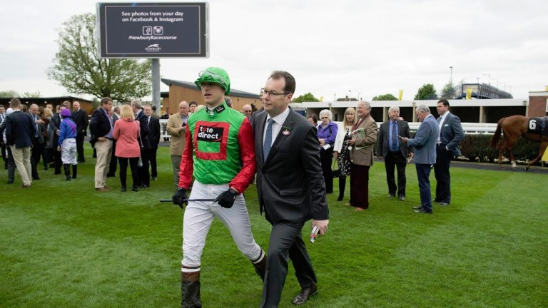 Out you go: the fake jockey is escorted from the parade ring