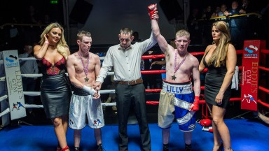WILLIAM CARSON GETS THE VERDICT AT LAST NIGHT'S CHARITY BOXING NIGHT AT NEWMARKET