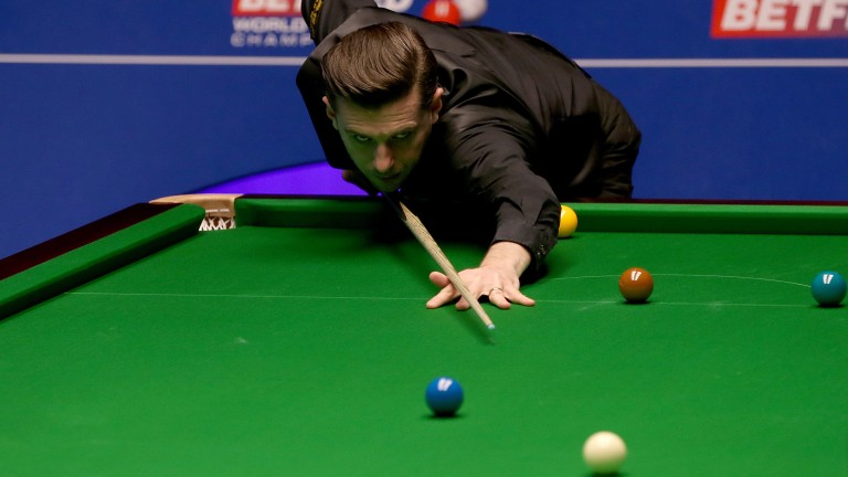 Crucible champion Mark Selby at the table against Fergal O'Brien in the first round