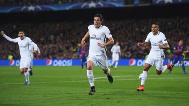 Edinson Cavani celebrates a Champions League goal with PSG teammates