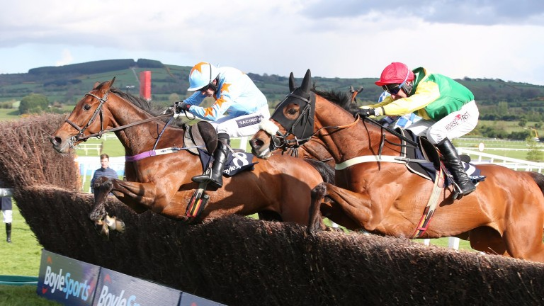 Fox Norton and Robbie Power (right) take the last with Un De Sceaux and Ruby Walsh in their sights