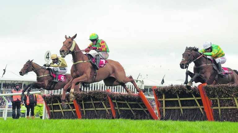 Nichols Canyon (left) crosses the final flight in the Stayers' Hurdle before seeing off Lil Rockerfeller (centre) and Unowhatimeanharry (right)