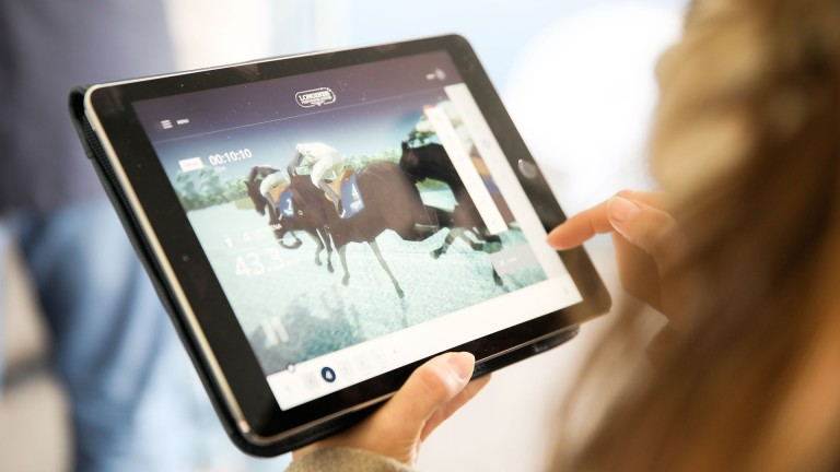 A guest uses the new Longines Positioning Systems App.
