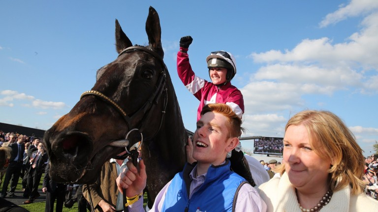 FAIRYHOUSE MON 6 APRIL 2015  PICTURE: CAROLINE NORRIS   THUNDER AND ROSES RIDDEN BY KATIE WALSH BEING LED IN AFTER WINNING THE BOYLESPORTS IRISH GRAND NATIONAL WITH SANDRA HUGHES ON RIGHT