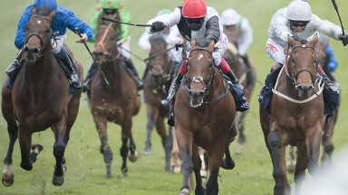 Cracksman fights out the finish to the Investec Derby Trial with Permian (far right)