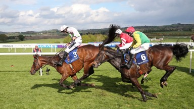Djakadam makes a mistake in front as he is pursued at the last by Sizing John (red cap), who got up by a short head, and Coneygree
