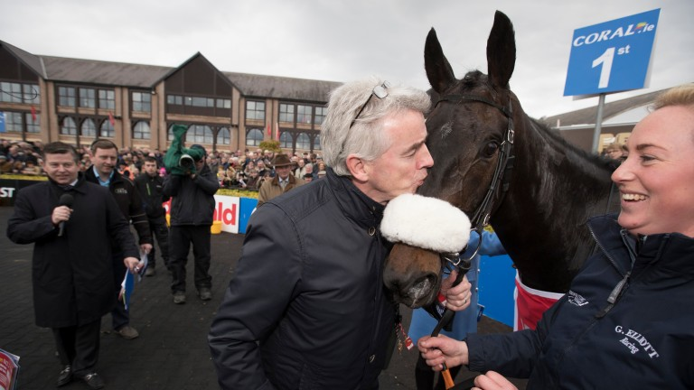 Michael O'Leary kisses Champagne Classic after his Grade 1 victory in the Irish Daily Mirror Novice Hurdle