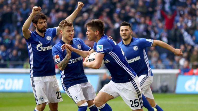 Klaas Jan Huntelaar (second right) celebrates with Schalke teammates