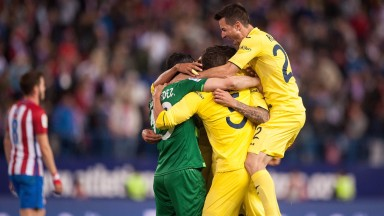 Villarreal players celebrate their victory over Atletico Madrid
