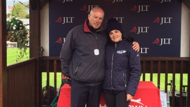 Olivia Smith with father Andy after completing her Wales to Ireland multi-marathon