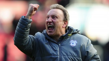 Cardiff boss Neil Warnock has agreed to stay on for next season