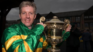 Golden moment: Noel Fehily looks pleased as punch with the trophy following his victory on Unowhatimeanharry in the Champion Stayers Hurdle