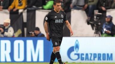 Porto defender Maxi Pereira trudges off afte receiving a red card