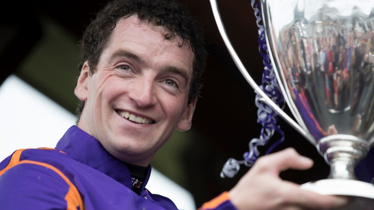 Patrick Mullins with the trophy after winning the Punchestown Champion Hurdle on Wicklow Brave