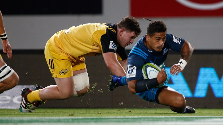 Scrum-half Augustine Pulu scores for the Blues against the Hurricanes