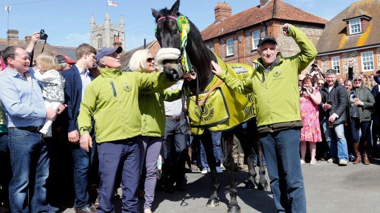 Many Clouds is greeted by the crowds in Lambourn after his Grand National victory