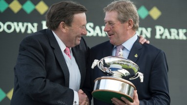 Nicky Henderson receives his fourth trainers' trophy from Olympic Gold medal winner Nick Skelton