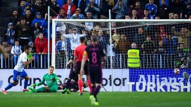 Jony Rodriguez scores Malaga's second goal against Barcelona
