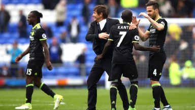 Antonio Conte and Chelsea players celebrate their win at Everton