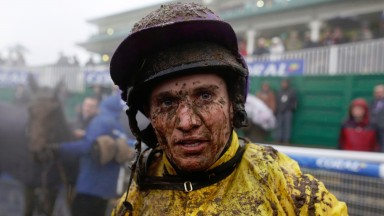 CHEPSTOW, WALES - JANUARY 09:  A muddy Jamie Moore after riding Mountainous to win The Coral Welsh Grand National at Chepstow racecourse on January 09, 2016 in Chepstow, Wales. (Photo by Alan Crowhurst/Getty Images)