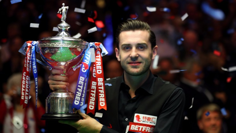 Mark Selby lifts the World Championship trophy for a third time in four years