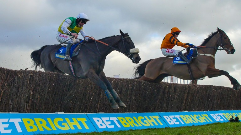 Thistlecrack (right) and Many Clouds jump the last in their epic duel in the Cotswold Chase at Cheltenham in January