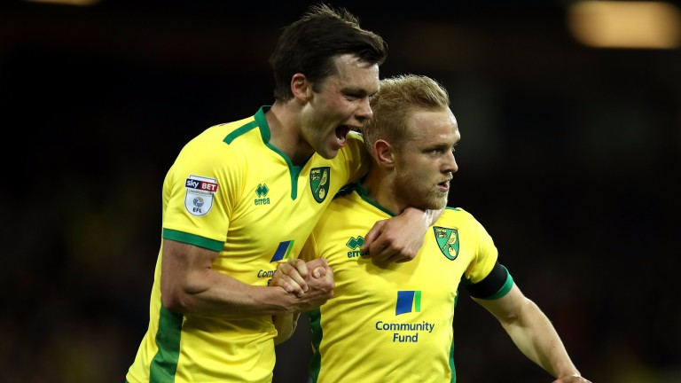 Norwich's Alex Pritchard (right) celebrates with Jonny Howson