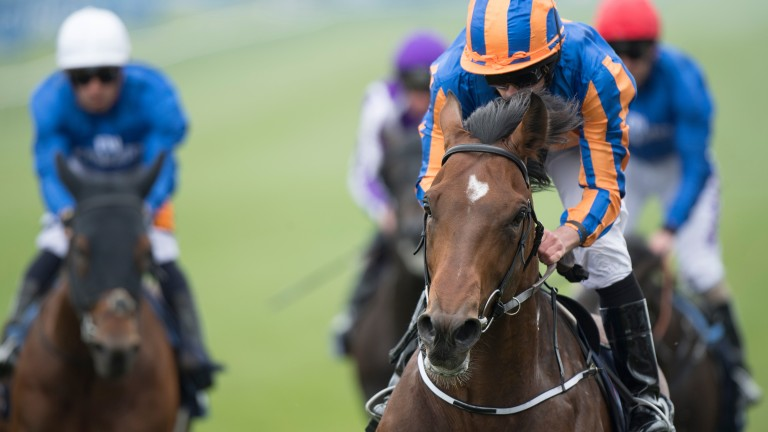Churchill (Ryan Moore, right) leads them home in the Guineas