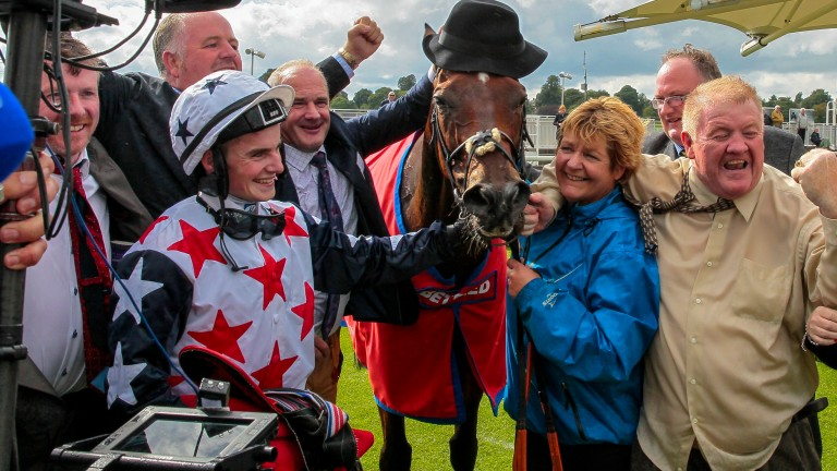 Heartbreak City (wearing hat) with his jubilant connections after his Ebor win at York last year