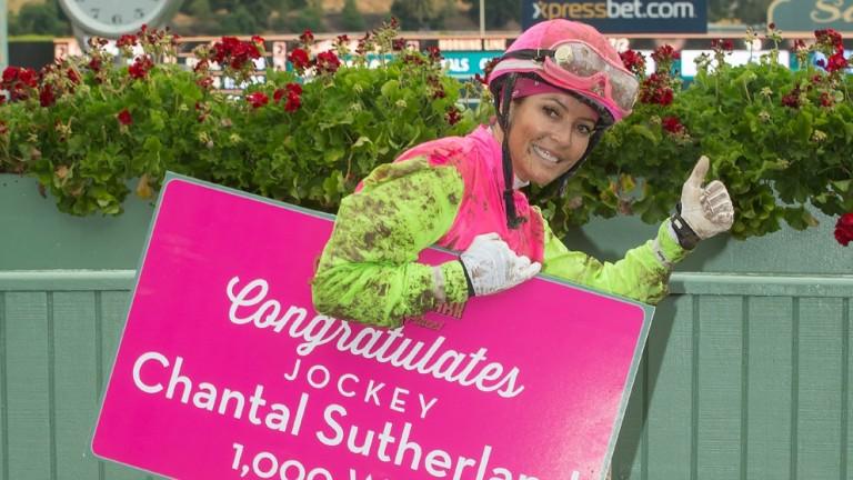 Chantal Sutherland celebrates her 1,000th career victory aboard Giro Candito in Saturday's third race at Santa Anita